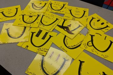 LaughFest Student Showcase Smiles on Table